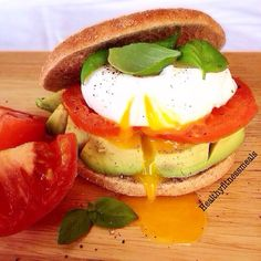 Avocado Poached Egg Sandwich  Avocado, tomatoes, poached egg salt and pepper to taste on toasted whole grain thin bagels.  Made by me @healthyfitnessmeals tag your healthy meals to #fitmealsfeature  Best meal of the day for me is breakfast. What about you? I CAN'T skip breakfast no way. I will literally pass out. Give me an idea of the things you like to see recipes for and I will gladly do my best to post them as I find them for you