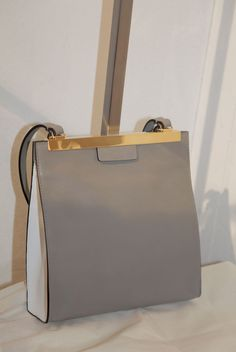 Marni Spring 2013 Fresh and adorable....grey with gold....elegant, regal...not your everday bag.