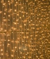 Frosted Pearl Mini Globe String Lights-wall behind sheers