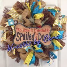 Spoiled dog!  A poly-burlap deco mesh wreath with ribbons galore including one with bones, paw prints and hearts and a sign that says it all!