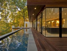 panorama-window-highlight-forest-infinity-pool-wood-terrace-wood-cover
