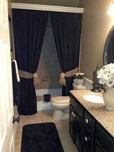 Crown molding to cover up the shower rod and two curtains pulled back. Love this look!