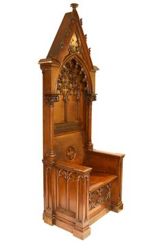 Breathtaking oak clergy's chair with hand carved inlay and floral & quatrefoil detailing and stylized arches.