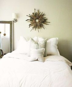 Driftwood Sunburst Wreath above Bed
