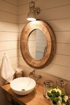 I love this mirror and the horizontal boards on the walls.  And the vessel sink.  OK, just the whole thing.  Not really, I don't love the light.