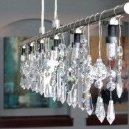 DIY Linear Crystal Chandelier. Old pipe and crystals from a broken chandelier or thrift shop.