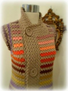 I'm all about knitting this days…simple knitting nothing fancy and, while I'm working with a furry yarn, my mind wonders around the idea of a stunning coat or vest that would wow the people around me