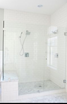 Master Bath built-in bench topped with marble - white subway tiles on the walls #MasterBathShowers #bathroomremodeling #masterbathrooms