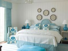 Pretty blues ... draperies, headboard and bedskirt all matching fabric....pillows and chairs in another....I like the mix!