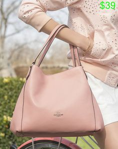 #The blush Edie shoulder bag makes a summer statement when worn with shades of pink. .......Follow Pink Bags: www.pinterest.com...... Get Your Free Course Viral Images for Pinterest Now at: CashForBloggers.com