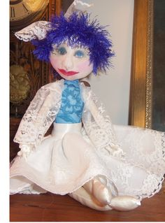 Blue, a pretty cloth doll with painted face.
