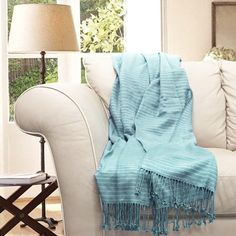 A bamboo throw blanket is ideal for cozying up after a day on the beach. | $40 | Blue beach decor | coastal decorating ideas #beach #coastal #decor