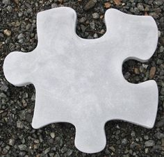 What a great idea for a paving stone! Puzzle Stepstone B Statue - Stepstones eclectic outdoor products
