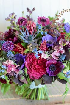Vibrant textural bridal bouquet in June. Designed by Love 'n Fresh Flowers.