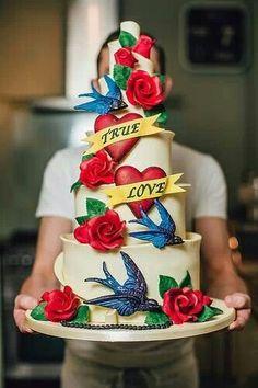 Tattoo inspired wedding cake #birds #roses #banner