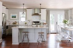 gray and white kitchen with wood floors