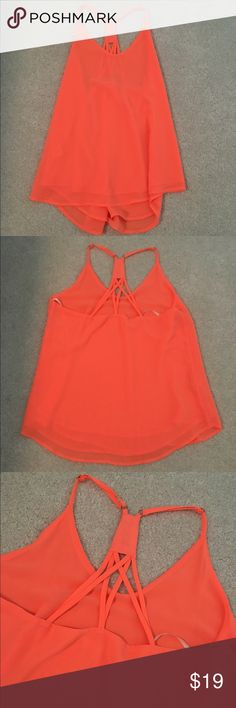 Neon coral/orange top Neon coral/orange tank. Never worn! Size small Tops Tank Tops