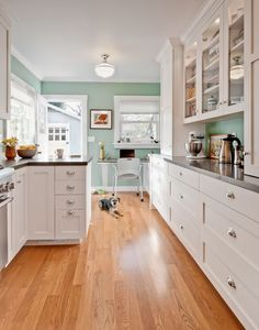 """Traditional Kitchen with flush light, French doors, U-shaped, Red Oak - Natural Solid Hardwood Plank (2.25""""/3.25""""/5""""), Flush"""
