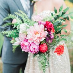You'd never guess, but this peony, zinnia, and rose bouquet is actually made entirely of silk blooms, purchased from Afloral and arranged by the bride herself. It's a great way to get the look you love for less.