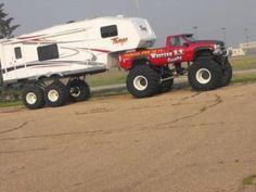 High roller...Monster-Truck towing a lifted fifth wheeler.