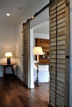 I love the idea of using weathered shutters as sliding barn doors