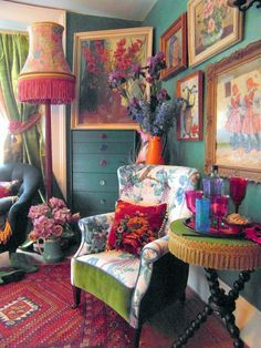 Bohemian Interior Decorated With Framed Painted Wall Arts And Flower Vases