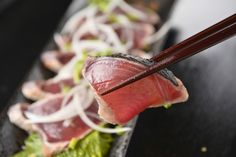 Katsuo no Tataki is bonito sashimi with extra preparation method. Katsuo no Tataki is specialty dish in Kochi prefecture.