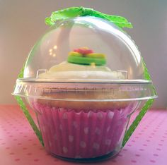 Cupcake favors - Clear plastic containers.  Can go with any theme!
