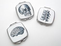 "Anatomy Compact Mirror set of three pocket purse accessories brain skull vertebrae. Anatomy compact mirrors, set of 3 -approximately 3"" x 2 1/2"" x 1/4"" -nice quality, one side regular magnification, other side 2x magnification -Fun party favors, stocking stuffers, hostess or housewarming gift, office gifts, medical student graduation -feel free to request all one image."
