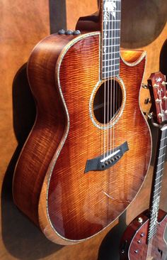 Stunning Taylor at Frankfurt 2014 - My idea of a definitive acoustic - sharp cutaway, stunning looks, amazing taylor quality (kind of electric guitar neck comfort).