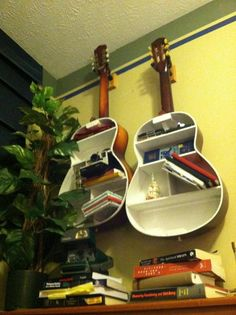 Have any old, unplayable, cheap guitars?  Great way to turn them into cool storage shelves.  Perfect for a music room, or musician's bedroom.