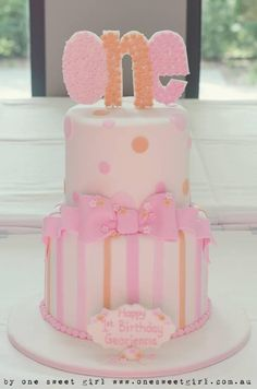 Pink bows, polka dots and stripes cake for 1 year old birthday party