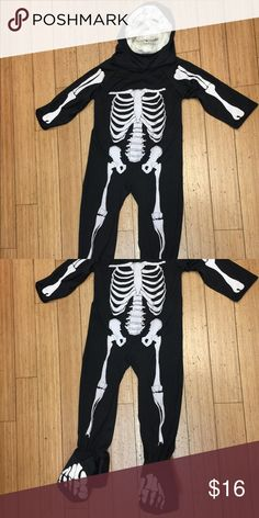 Skeleton costume Good condition size 4.  Mask is separate piece and feet have stirrups to fit over shoe Costumes Halloween