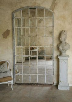 Wall mirror that was fashioned out of circa 1880-1900 iron windows from an old Belgian factory.