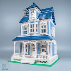 A medium blue custom LEGO Victorian House Modular with awesome features and classic details. Modeled after classic Victorian style of architecture with 2 floors and an attic, Front-Gabled Roof and Patio with a swing. Interior includes a bedroom, fireplace with recliner, full kitchen/dining and a folding ladder to access the attic full of hidden surprises including a resident spider and mouse.