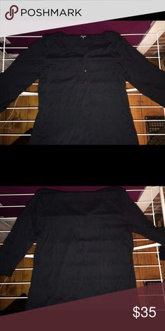 Black cotton pullover. SOFT Garnet Hill size L. Black cotton deep V shirt. 3/4 sleeves. One button. Makes a great layering shirt. NWOT. I bought this shirt in several colors and never wore this color Garnet Hill Tops Tunics