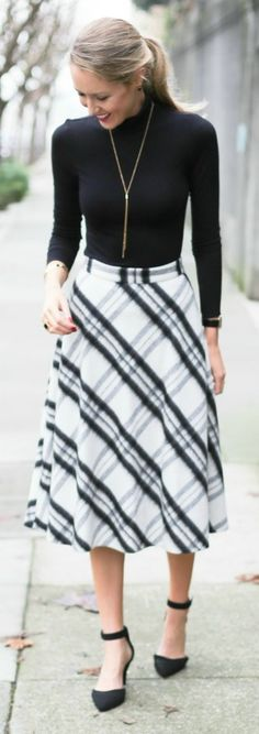 mixed plaids: black and white plaid bias cut circle midi skirt, hooded plaid wrap belted coat, chunky knit infinity scarf + ankle strap pumps