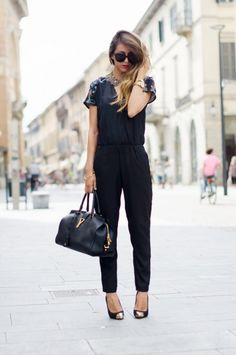 all black outfit, jumpsuit, with hints of gold, balayage hair and bright lipstick to add  colour. love the gold pointed heels, they give the outfit some extra edge.
