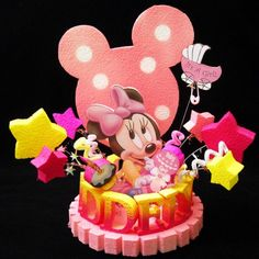 "This is a personalized BABY SHOWER MINNIE MOUSE CAKE TOPPER/ CENTERPIECE. Everything is hand made and painted. This topper will include the name of the birthday boy/ girl or BABY. This is a wonderful piece to make your cake stand out and it matches with the Disney Babies birthday party theme. Special attention was given to detail to achieve a clean and sturdy finish. For this Cake Topper the characters are glued on 1"" inch foam board. Also, I used Styrofoam for the 8"" diameter base and…"