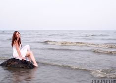 My favorite photos are those that tell a story...and my favorite part of THAT is that they tell a different story depending on the observer.    mermaid, alone, lake, fairy tale, white dress, red head, Milwaukee photographer, rock, fog, blue, longing, LotusFly Photography