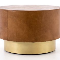 Details add depth to a deceptively simple shape. Hand-stitched copper leather offsets a bright brass base with rivet detail for a striking material mix and mid-century spirit. Perfect in pairs as the new alternative to the traditional coffee table. Luke's Coffee, Leather Ottoman Coffee Table, Traditional Taste, Copper Material, Burke Decor, Modern Coffee Tables, Mid Century Style, Simple Shapes, Metal Finishes
