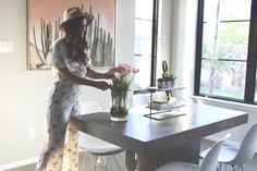 Floral Spring Jumpsuit with Brown Hat in a Modern Townhouse