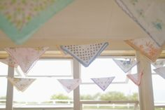 great idea for a party decoration: bunt old hankies and pocket squares over linen and hang like flags!
