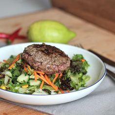 An open face burger with spicy asian style salad dressing. Great meal to throw together on a weeknight or for a grill party!