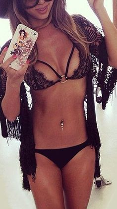 You can be sure to look smoking hot on the beach this summer if you opt for this incredibly mesmerizing black lace strappy bikini set. It's one of those swimsuits that can definitely take your sex appeal off the hook. It's beguiling and absolutely stunning that you'll surely be a standout. This remarkable bikini set is made of a stretchable fabric and features a nude lining on the bikini top. It has an uber-sexy lace panel with thin strap detailing. Its bikini bottom has a low-rise design…