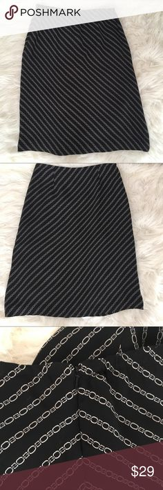 Talbots Petite's Black Skirt Talbots Petite's Black White/Off White Skirt. Size 8P. This will fit a normal 8, just won't be as long. Fully lined. Waist measuring laying flat across is approx 14.5 (very little stretch to this). Length is approx 25.5. Side zipper. Snag on bottom in one side as seen in picture. Not really noticeable since this is a longer Skirt (my opinion only) Talbots Petites Skirts Midi