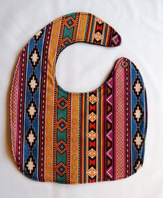 This is a beautiful Native American inspired baby bib that is sure to be a hit with babies and mommies alike! They are a smaller size