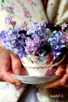 Flower arrangement in a teacup! So much colour!