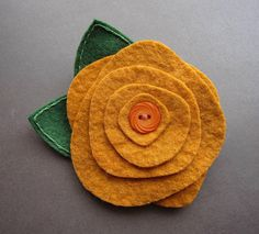 Arts and Crafts Rose... I'd love to make this. Now, where does one get good but affordable felt?