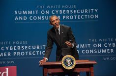 US President Barack Obama signs an executive order promoting private sector cybersecurity information sharing after speaking at the White House Summit on Cybersecurity and Consumer Protection at Stanford University in Palo Alto, California on February 13, 2015.